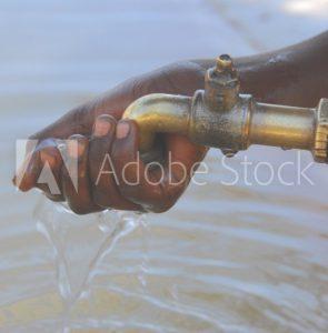hand under tap